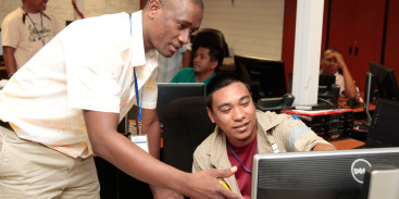 Ambatovy employee receiving learning support from an instructor in the Training Center